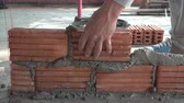 bricklayer : Worker building masonry house wall