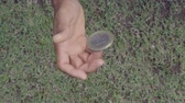 slowmotion shot tossing coin to flip on heads or tails Stok Video