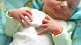 natal : ugly newborn baby with tiny hand in focus. shaking hands