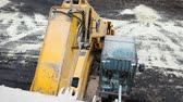 icicles : First-person view. In the yellow crane bucket. Descends to the ground. Stock Footage