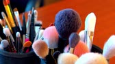 papier : makeup brushes are on the table