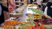 lunchroom : Restaurant guests select food from a buffet.