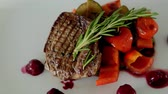 charbroiled : steak with fried vegetables is on the table