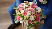 wedding : Groom is holding bridal bouquet in the hands of 2 Stock Footage