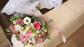 постельные принадлежности : wedding dress and bouquet lying on the bed, the bride is getting ready for the ceremony, womens accessories