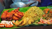 frigideira : Asian cuisine, traditional dishes, street food on the night market, rice and noodles with seafood, travel and tourism