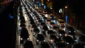 автомобильный : Traffic jam on the busy street during rush hour at night time