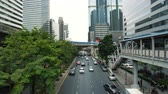 multilane : Heavy traffic along avenue in the city business district with skyscrapers at background Stock Footage