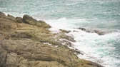 sea waves break on the rocky shore. foaming water, the restless sea