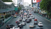 fast moving : A busy street in the center of the metropolis at the daytime in summer. Car traffic on the multi-lane roadway on the Avenue Stock Footage