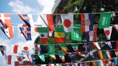 連邦政府の : Flags of different countries are hung in the air above the street. The world sports event concept