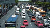 preso : Traffic jam on a busy downtown road. Cars and bus filled the urban street at rush hour Stock Footage