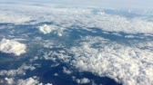 letectví : Flight high above land in clouds. On sky view. Aerial flyght in blue sky.