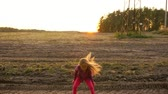 clap : Crazy young caucasian girl dancing Rock N Roll outdoors. White girl jumping on field rural scene. Stock Footage