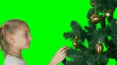 entusiasta : Alpha channel transparent background. Excited young white girl decorating christmas tree and with happy looking to firtree. Preparing for Merry Christmas and Happy New Year celebrate Holiday.