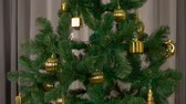 ladin : Green fir-tree with golden decoration rotate. Tamplate for greeting card to celebrate Merry Christmas and Happy New Year Holiday. Stok Video