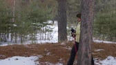 pensão : Senior woman training nordic walk during hiking in winter forest