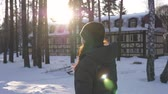mrożonki : Woman walking in snowy park with sun beams in winter