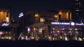 sharjah : Sharjah, UAE - May 10, 2018: night cafe with bright backlight on embankment Khalid lake in Sharjah city in United Arab Emirates. Cafe and restaurant in night Sharjah city UAE. Stock Footage