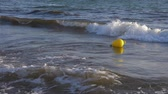 буй : Yellow buoy floating in sea water slow motion. Sea buoy floating on water waves.