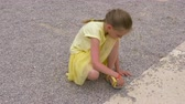 travessura : Playful girl teenager putting little gravel stones in shoes for prank Vídeos