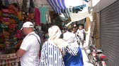 souk : Tunis, Tunisia - 06 June 2018: Arabian women walking on local market Tourist people shopping souvenirs and gifts on arab bazaar while travel. Stock Footage