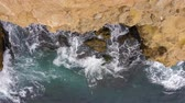 close up view : Aerial top view of sea waves near rocks with natural light