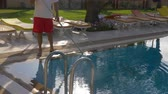 шланг : Hotel worker cleaning water in swimming pool, cropped view Стоковые видеозаписи