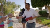 içten : Monastir, Tunisia - 08 June 2018: excursion guide and tourist people going on travel trip. Tourist people talking with excursion guide and walking to bus.