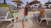 ginasta : Little girl practicing yoga in Pigeon pose asana on beach