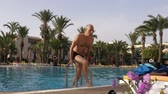 estância turística : Man getting out of outdoor swimming pool in hotel on resort