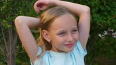 игривый : Cute blonde playful young girl, portrait