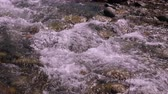 fast river : Fast waterflow of mountain river in slow motion, close up
