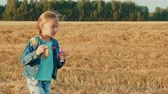 golpe : Beautiful young girl blowing soap bubbles during rotation in autumn field Stock Footage