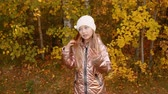 gold coloured : Funny teenager girl dancing and posing front camera in autumn forest Stock Footage