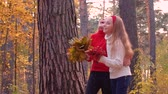 travessura : Playful teenager girl laughing and smiling front camera in autumn park