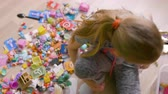 игривый : Top view of blonde girl playing with toys on floor at home