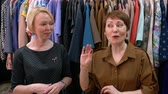 butik : Two middle age women designers talk about fashion trends in clothing. Close-up portrait.