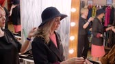 atriz : Senior fashion model trying clothes in dressing room before fashion show. Mature woman actress preparing to performance on theater scene. Fashioh, beauty and art concept Stock Footage