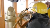 bússola : Senior Woman Steer Ship Wheelhouse Captain Cabin. Elderly Caucasian Sailor Boat Crew Vessel Control Equipment. Sea Transportation Marine Machine Deck Device Navigation System Concept Back View 4K