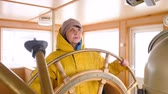 leva : Elderly Woman Turn Steer Wheel Navigation Control. Caucasian Sailor Sea Vessel Wheelhouse Equipment Captain Cabin Background. Nautical Instrument Marine Job Strategy Nautics Concept 4K
