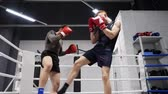 self defence : Two boxer man training kick by legs on boxing ring. Low angle view. Boxer man training together personal trainer in gym club. Boxing training. MMA concept. MMA K1 martial arts