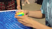 kubus : Sochi, Russia - August 10, 2019: teenager hands collecting Rubik Cube. Male hands architect Rubik Cube. Young man trying to solve intellectual puzzle Stockvideo