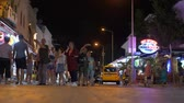 дорожный знак : Marmaris, Turkey - September 23, 2019: tourist people walks by shopping street evening night. Colorful artificial lights of stores and pedestrian street summer night low key