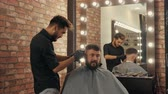razor shave : Hairdresser doing hair cut with hair machine for brutal man in barber shop. Barber making hairstyle with electrical shaver in male salon. Bearded man in barber shop