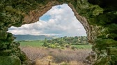 establishing shot : View from ruins of ancient Myus tunnel looks out to spectacular valley and cloudscape, Turkey. Time lapse 4K.