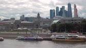 establishing shot : Moskva River with boats, Kievsky Railway Station Square, Moscow-City skyscrapers in the summer day, Moscow, Russia, 4k. Other camera movements, raw flat color, frame rates, formats, and resolutions are available upon request.