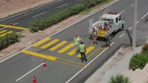 yellow : Painting of a new pedestrian crosswalk in progress. Time lapse, 4k