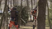 awful : a battle between two samurai in the forest Stock Footage