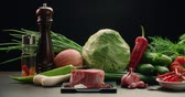 káposzta : beautiful composition of vegetables, meat and spices on the table, products for cooking Asian dishes, dolly shot